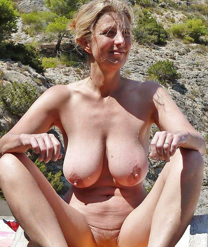 image Granny at the beach sucking every cock she se