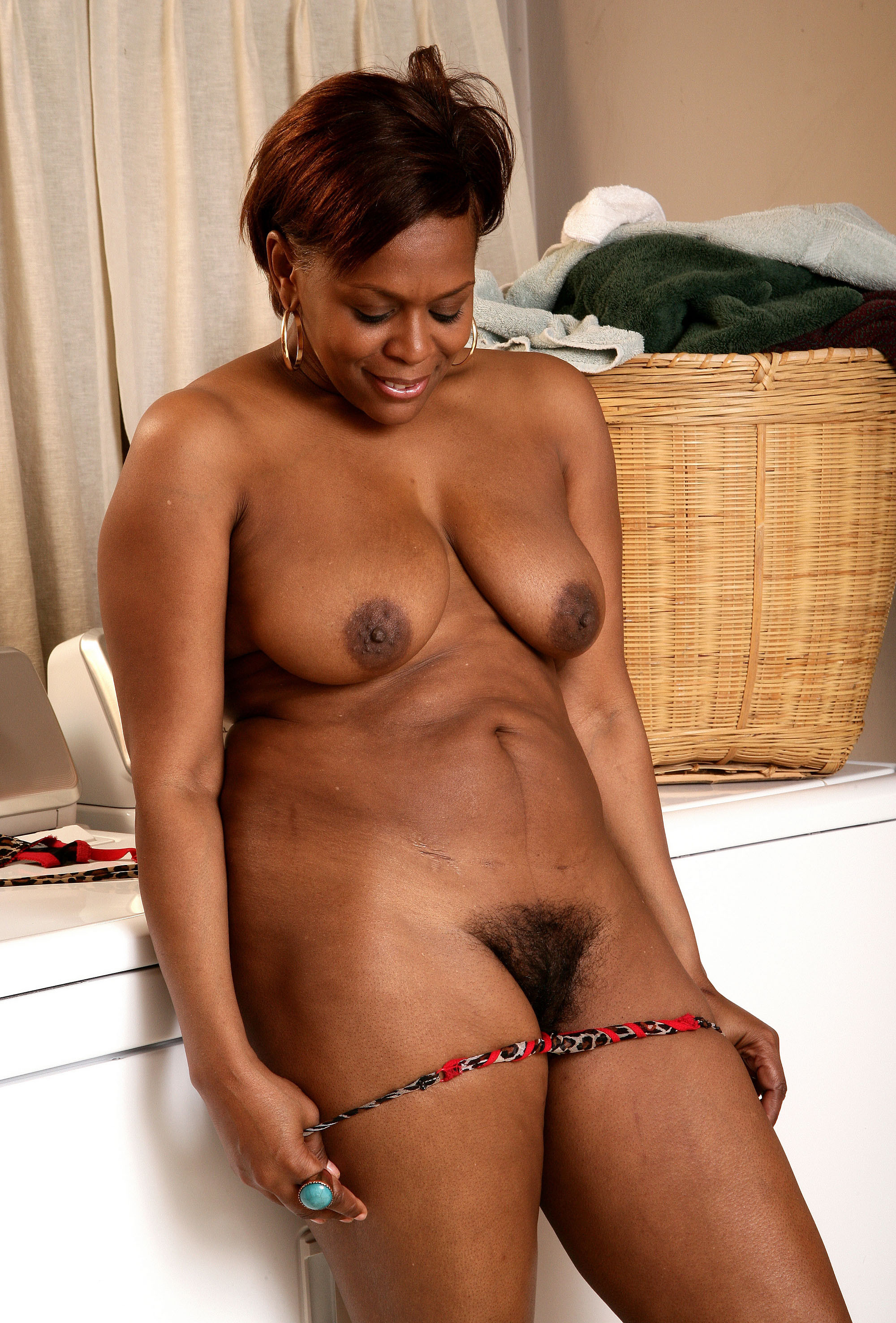 Covering an ebony mature face with my cum 9