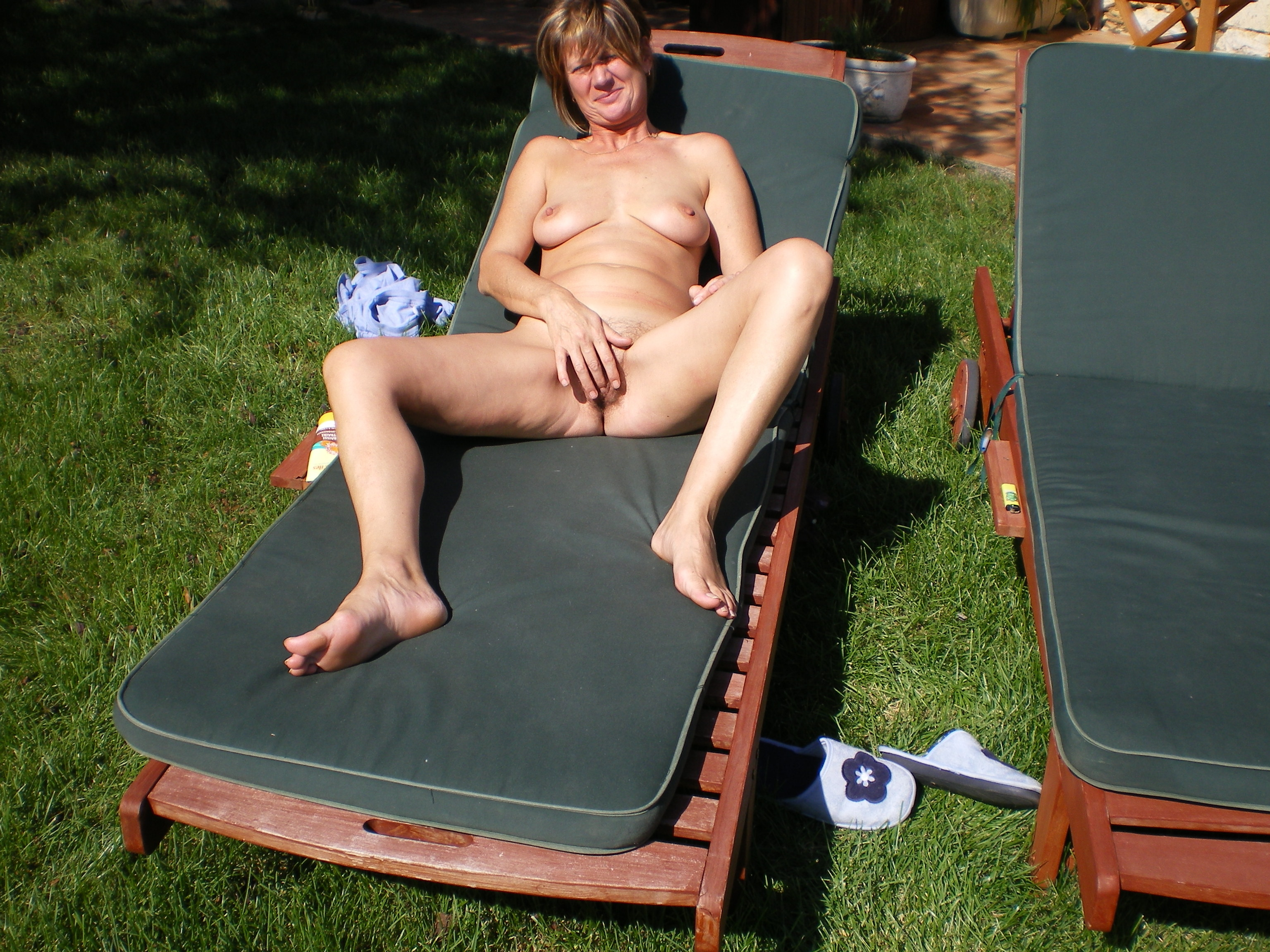 Nude my wife sunbathing